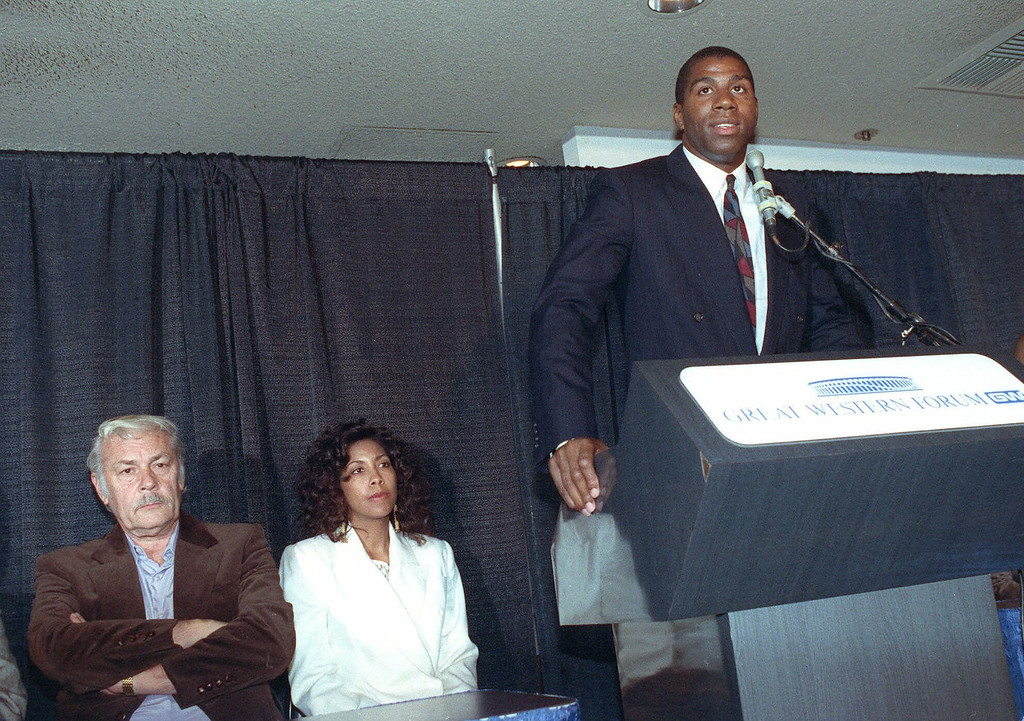 """. Earvin \""""Magic\"""" Johnson announces his retirement from the Los Angeles Lakers as Lakers\' owner Dr. Jerry Buss, left, and Johnson\'s wife Earletha, known as Cookie, center, listen during a press conference Nov.7, 1991 at the Forum in Inglewood, Calif.  Johnson said he decided to retIre from professional basketball after testing positive for the AIDS virus. (AP Photo/Nick Ut) Earletha (Cookie) Kelley"""