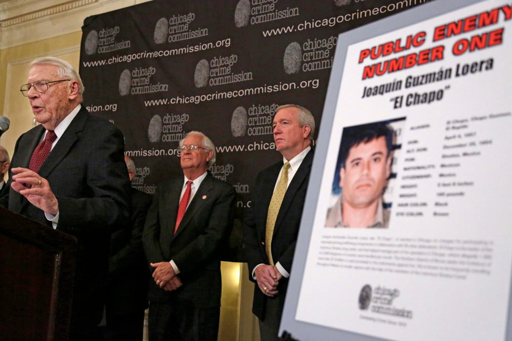 . In this Feb. 14, 2013 file photo, Art Bilek, executive vice president of the Chicago Crime Commission, left,  announces that Joaquin ``El Chapo\'\' Guzman has been named Chicago\'s Public Enemy No. 1, during a news conference in Chicago. A senior U.S. law enforcement official said Saturday, Feb. 22, 2014 that Guzman, the head of Mexico\'s Sinaloa Cartel, was captured alive overnight in the beach resort town of Mazatlan, Mexico. Guzman faces multiple federal drug trafficking indictments in the U.S. and is on the Drug Enforcement Administration?s most-wanted list. His cartel has been heavily involved in the bloody drug war that has torn through parts of Mexico for the last several years. (AP Photo/M. Spencer Green, File)