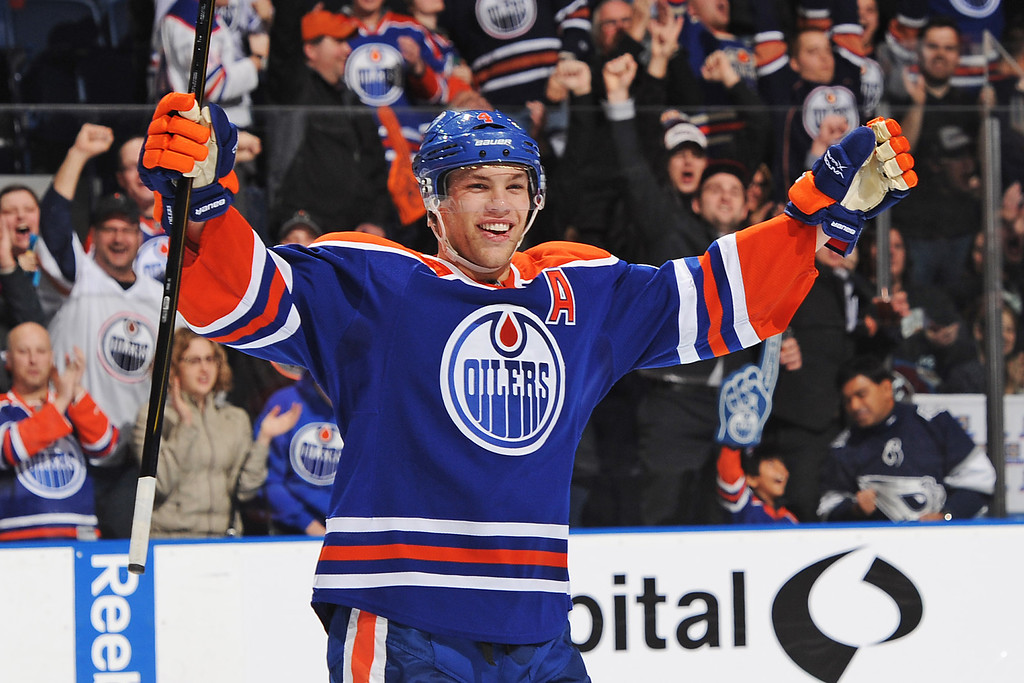 . EDMONTON, CANADA - FEBRUARY 16: Taylor Hall #4 of the Edmonton Oilers celebrates the empty net goal by his teammate Jordan Eberle #14 (not pictured) against the Colorado Avalanche during the NHL game at Rexall Place on February 16, 2013 in Edmonton, Alberta, Canada. Oilers won 6-4. (Photo by Derek Leung/Getty Images)