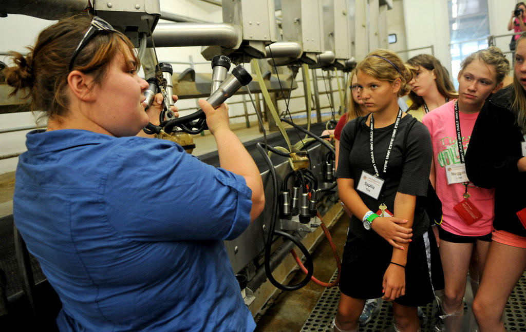. Mill Valley Farm herd manager Allison Kirker, left, talks about dairy farm\'s technology to students in the Camp Badger Exploring Engineering program. (Pioneer Press: Jean Pieri)