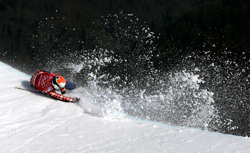 . Canada\'s Brady Leman crashes in the men\'s ski cross final at the Rosa Khutor Extreme Park at the 2014 Winter Olympics, Thursday, Feb. 20, 2014, in Krasnaya Polyana, Russia. (AP Photo/Sergei Grits)