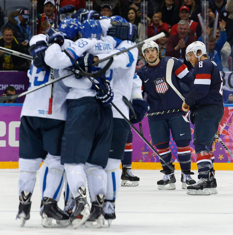 . USA defenseman Justin Faulk and forward Joe Pavelski react as Finland celebrates a goal during the third period of the men\'s bronze medal ice hockey game at the 2014 Winter Olympics, Saturday, Feb. 22, 2014, in Sochi, Russia. (AP Photo/Mark Humphrey)