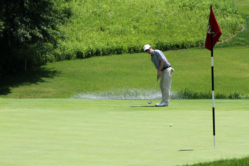 No putt is an easy putt at Meridian Hills Country Club. This junior lags one close to the flag stick during the first round. (WGA Photo/Ian Yelton)