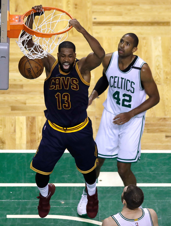 . Cleveland Cavaliers center Tristan Thompson follows through on a dunk in front of Boston Celtics center Al Horford (42) during the second quarter of Game 1 of the NBA basketball Eastern Conference finals, Wednesday, May 17, 2017, in Boston. (AP Photo/Charles Krupa)