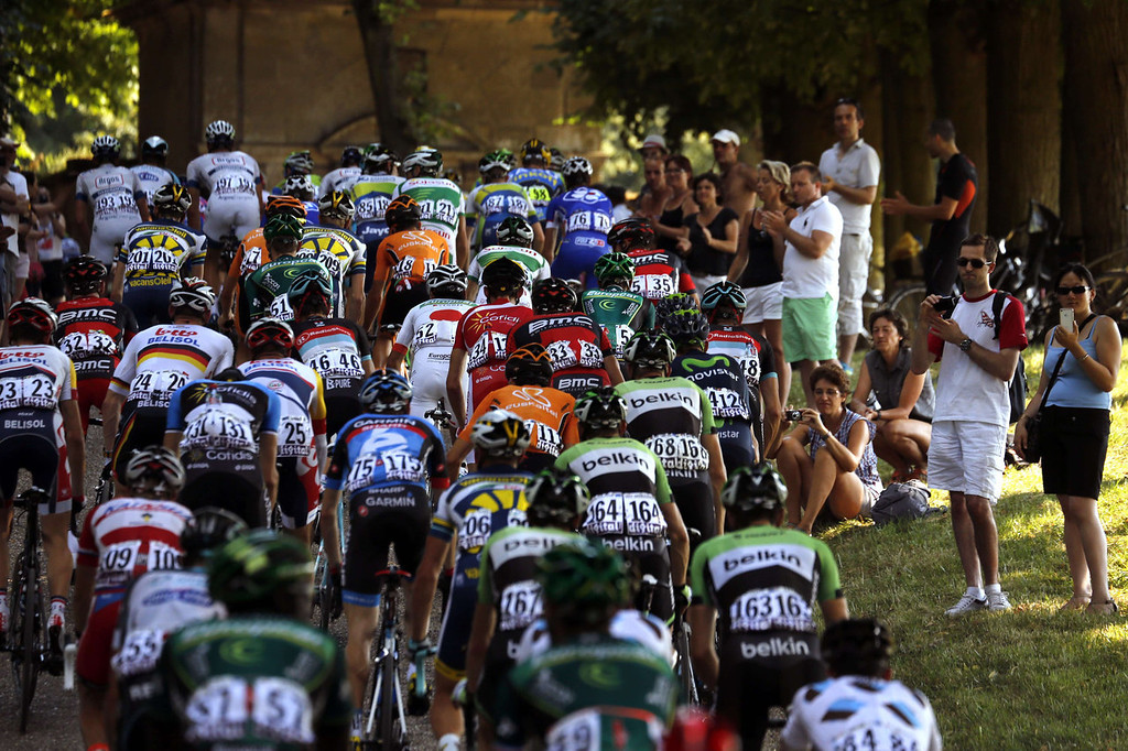 . The pack rides as supporters cheer during the 133.5 km twenty-first and last stage of the 100th edition of the Tour de France cycling race on July 21, 2013 between Versailles and Paris.  PASCAL GUYOT/AFP/Getty Images