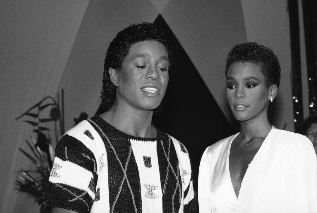 ". Jermaine Jackson, left, one of the Jackson brothers, is shown with singer Whitney Houston, during rehearsal for a segment of ""As The World Turns, \"" July 25, 1984, in New York.  (AP Photo/Marty Lederhandler)"