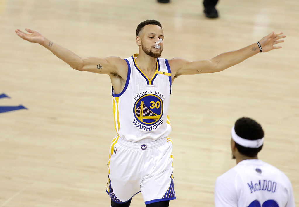 . Golden State Warriors guard Stephen Curry (30) reacts during the second half of Game 5 of basketball\'s NBA Finals against the Cleveland Cavaliers in Oakland, Calif., Monday, June 12, 2017. (AP Photo/Marcio Jose Sanchez)