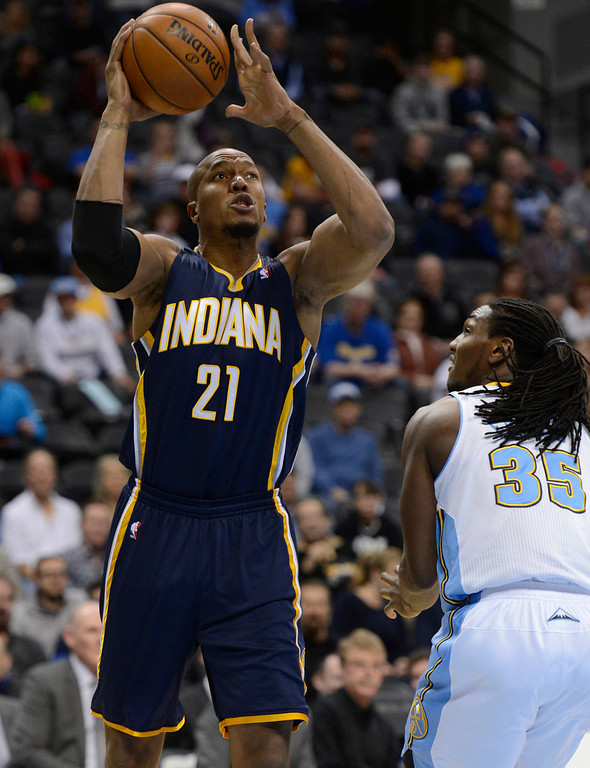 . DENVER, CO. - JANUARY 28: Indiana Pacers power forward David West (21) takes a shot over Denver Nuggets small forward Kenneth Faried (35) during the first quarter January 28, 2013 at Pepsi Center. The Denver Nuggets host the Indiana Pacers in NBA action.  (Photo By John Leyba / The Denver Post)