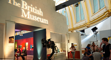 . Bettany Hughes, British historian and reporter, alongside Snow guide viewers through the exhibit. © British Museum