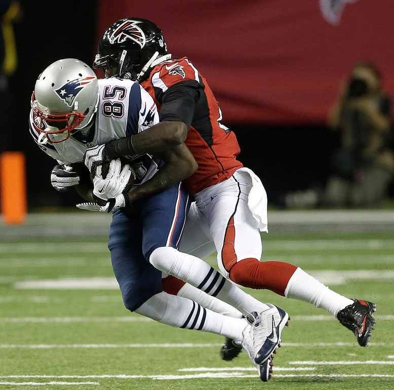 . New England Patriots wide receiver Kenbrell Thompkins (85) makes the catch against Atlanta Falcons free safety Thomas DeCoud (28) during the second half of an NFL football game, Sunday, Sept. 29, 2013, in Atlanta. (AP Photo/John Bazemore)