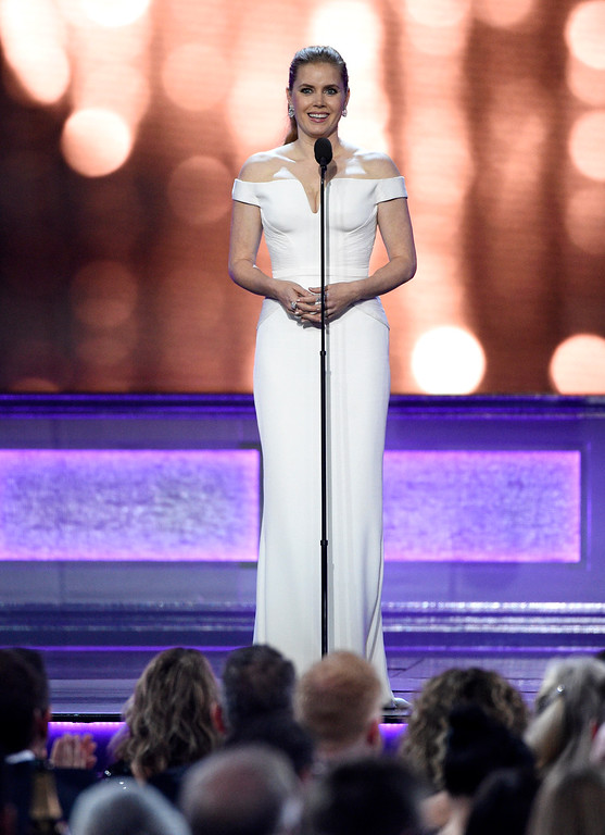 . Amy Adams presents the #SEEHER award at the 22nd annual Critics\' Choice Awards at the Barker Hangar on Sunday, Dec. 11, 2016, in Santa Monica, Calif. (Photo by Chris Pizzello/Invision/AP)