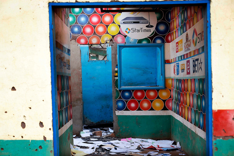 . A Muslim owned satellite television shop stands looted in the Miskin district of Bangui, Central African Republic, Tuesday Feb. 4, 2014. (AP Photo/Jerome Delay)
