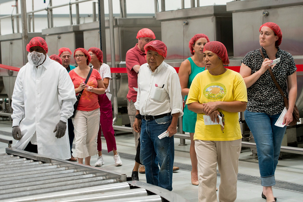 . Guests tour the Sriracha hot sauce factory to see the chili grinding process at Huy Fong Foods in Irwindale on Friday, August 22, 2014. (Photo by Watchara Phomicinda/ Pasadena Star-News)