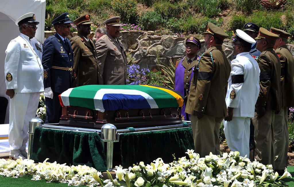 . Military soldiers stand at attention over South African President Nelson Madela\'s casket before his burial in his home village of Qunu, South Africa, Sunday, Dec. 15, 2013. (AP Photo/Elmond Jiyane, CGIS)
