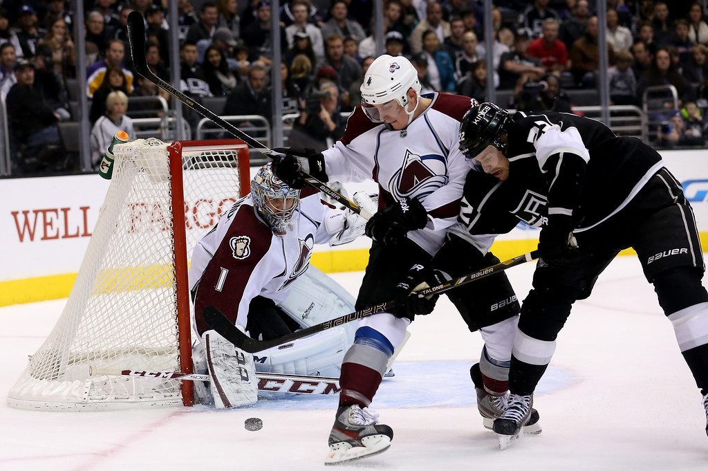 . LOS ANGELES, CA - DECEMBER 21: Goalie Semyon Variamov #1 of the Colorado Avalanche guards the net as Tyson Barrie # fo the Avalance and Trevor Lewis #22 of the Los Angeles Kings battle at Staples Center on December 21, 2013 in Los Angeles, California.  (Photo by Stephen Dunn/Getty Images)