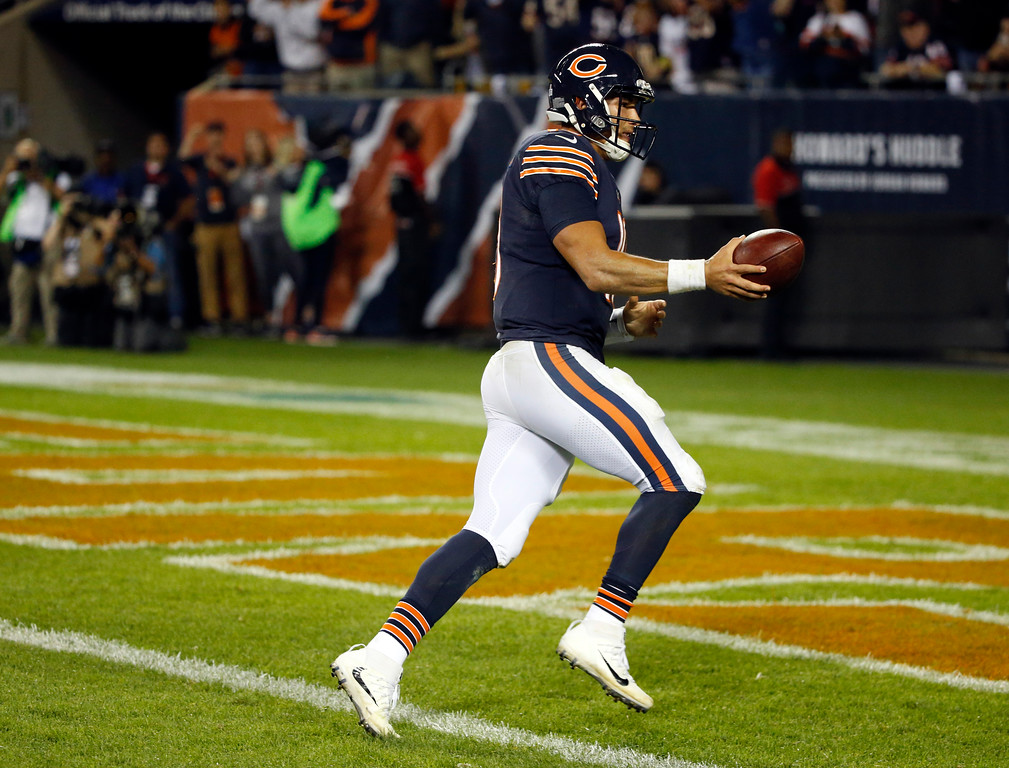 . Chicago Bears quarterback Mitchell Trubisky (10) runs to the end zone for a two-point conversion play during the second half of an NFL football game against the Minnesota Vikings, Monday, Oct. 9, 2017, in Chicago. (AP Photo/Charles Rex Arbogast)
