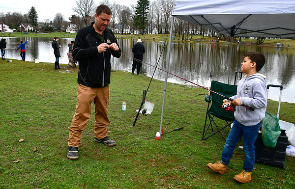 4//13/2019 Mike Orazzi | Staff Chris Adkins and his son Chris Adkins Jr.9, during the city of New Britain's annual fishing derby held at Stanley Quarter Park on Saturday.