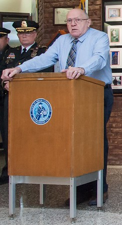 Police commission member Bob Peters speaks, then as a chairman, during a promotion ceremony last year. | Wesley Bunnell | Staff
