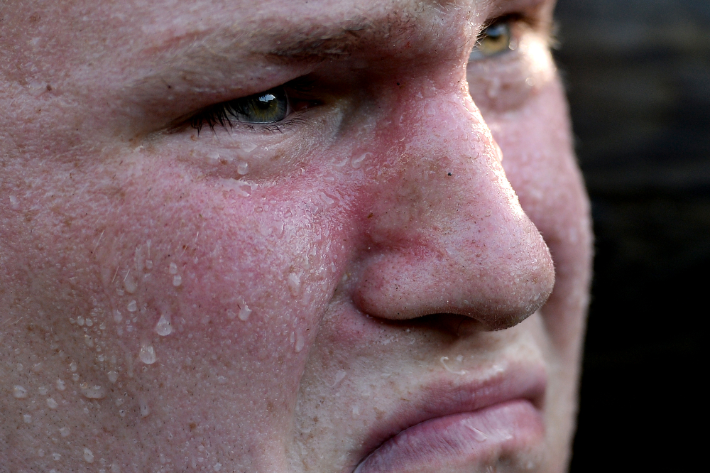 . A member of the United States Naval Academy freshman class sweats as he lifts logs during the annual Sea Trials training exercise at the U.S. Naval Academy on May 13, 2014 in Annapolis, Maryland. (Photo by Patrick Smith/Getty Images)