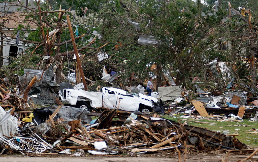 . Crushed autos sit amid the rubble as emergency personnel continue search efforts to locate people in that are unaccounted for in the destroyed Rancho Brazos neighborhood of Granbury, Texas, Thursday, May 16, 2013. (AP Photo/The Fort Worth Star-Telegram, Paul Moseley)
