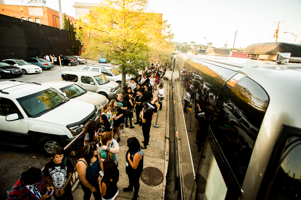 Line outside the bus for people waiting to get into the show