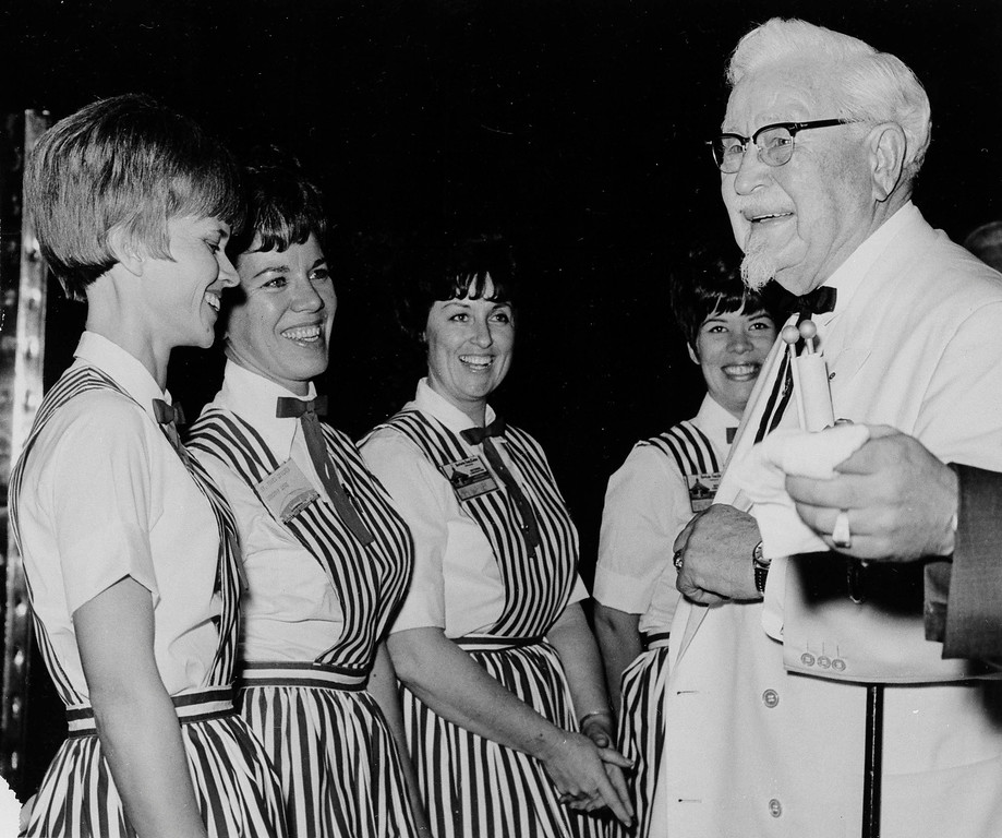 . Col. Harlan Sanders, who operates Kentucky Fried Chicken stands across the country, meets employees on visit to the Sahara Hotel in Las Vegas, Jan. 21, 1969. Sanders was in town for the company\'s convention. (AP Photo)
