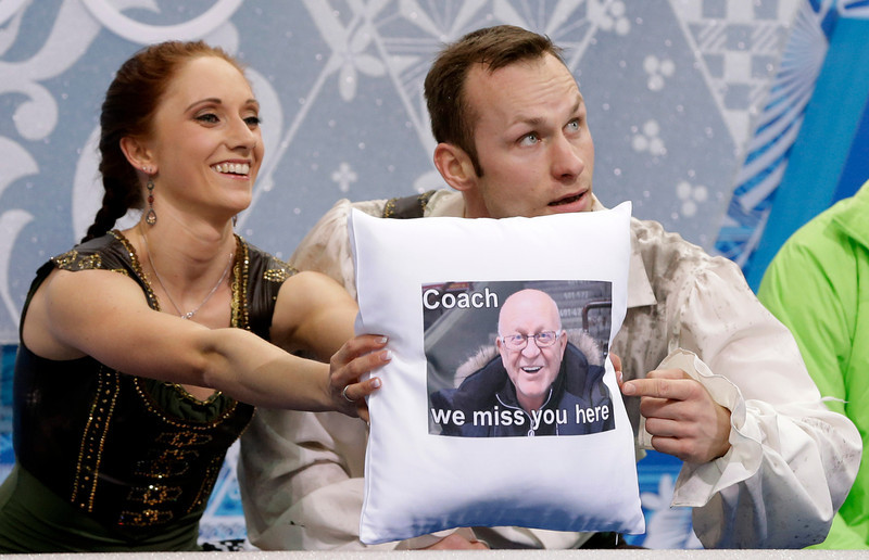 . Maylin Wende and Daniel Wende of Germany hold up a cushion bearing a photograph of their coach Karel Fajfr as they wait in the results area after competing in the pairs free skate figure skating competition at the Iceberg Skating Palace during the 2014 Winter Olympics, Wednesday, Feb. 12, 2014, in Sochi, Russia. (AP Photo/Darron Cummings)