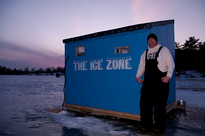 Ron Doughty in front of his Ice Zone ice shack, Sabattus Pond, Maine.