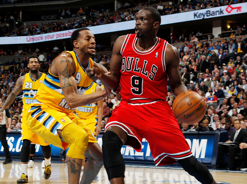 . Chicago Bulls forward Luol Deng, right, of the Sudan, works ball inside against Denver Nuggets guard Andre Iguodala in the second quarter of an NBA basketball game in Denver on Thursday, Feb. 7, 2013. (AP Photo/David Zalubowski)