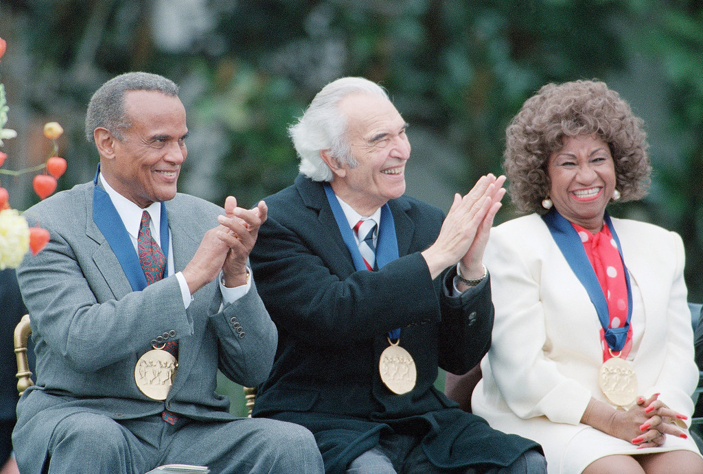 . Actor-singer Harry Belafonte left, jazz musician and composer Dave Brubeck, center, and singer Celia Cruz, at the White House Friday, Oct. 14, 1994, Washington, DC. They received 1994 National Medals of Arts. (AP Photo/Joe Marquette)