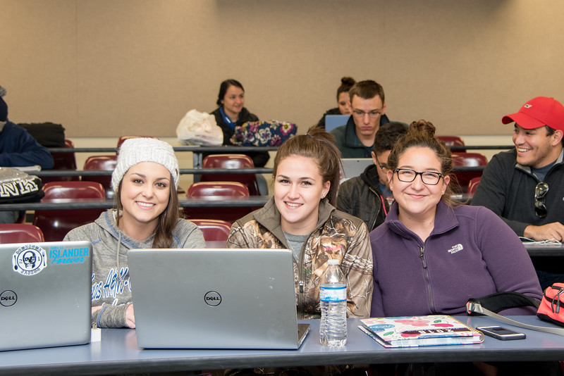 Allie Krueger (left), Morgan Rizzuto, and Marisa Bauer wait for the arrival of their Epidemiology professor on the first day of class.