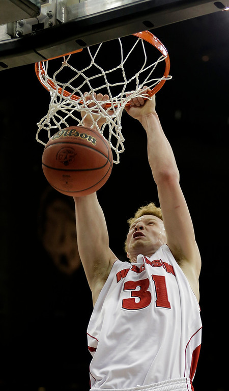 . Wisconsin forward Mike Bruesewitz (31) dunks the ball during the first half of a second-round game against Mississippi in the NCAA college basketball tournament Friday, March 22, 2013, in Kansas City, Mo. (AP Photo/Charlie Riedel)