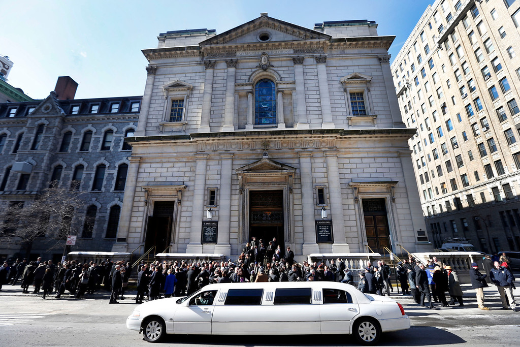 . Mourners congregate outside the Church of St. Ingatius Loyola following the funeral of actor Philip Seymour Hoffman Friday, Feb. 7, 2014, in New York.  Hoffman, 46, was found dead Sunday of an apparent heroin overdose. (AP Photo/Jason DeCrow)