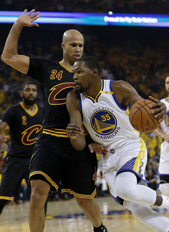 . Golden State Warriors forward Kevin Durant (35) dribbles against Cleveland Cavaliers forward Richard Jefferson (24) during the first half of Game 5 of basketball\'s NBA Finals in Oakland, Calif., Monday, June 12, 2017. (AP Photo/Marcio Jose Sanchez)