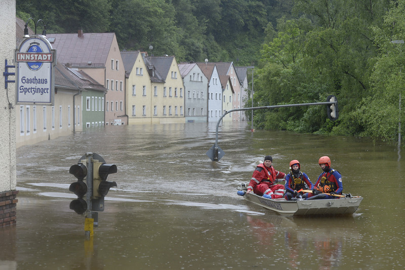 . Rescuers navigate through an overflooded street in Passau, southern Germany, on June 3, 2013. Parts of the eastern and southern Germany were flooded due to heavy and ongoing rainfalls.  CHRISTOF STACHE/AFP/Getty Images