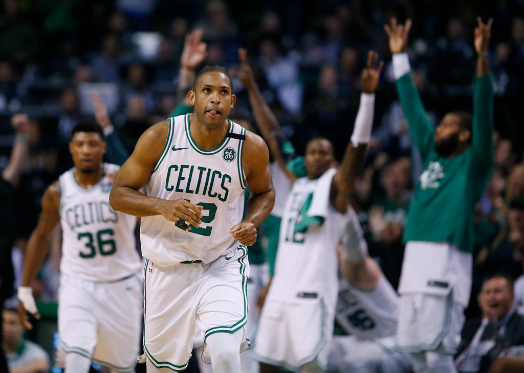 . Boston Celtics bench players cheer as forward Al Horford (42) and guard Marcus Smart (36) head upcourt during the second quarter of Game 1 of the NBA basketball Eastern Conference Finals against the Cleveland Cavaliers, Sunday, May 13, 2018, in Boston. (AP Photo/Michael Dwyer)