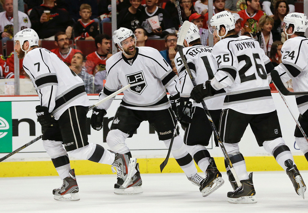 . Los Angeles Kings right wing Justin Williams, second from left, smiles with teammates after scoring a goal against the Chicago Blackhawks in the first period of Game 1 of the NHL hockey Stanley Cup Western Conference finals, Saturday, June 1, 2013, in Chicago. (AP Photo/Nam Y. Huh)