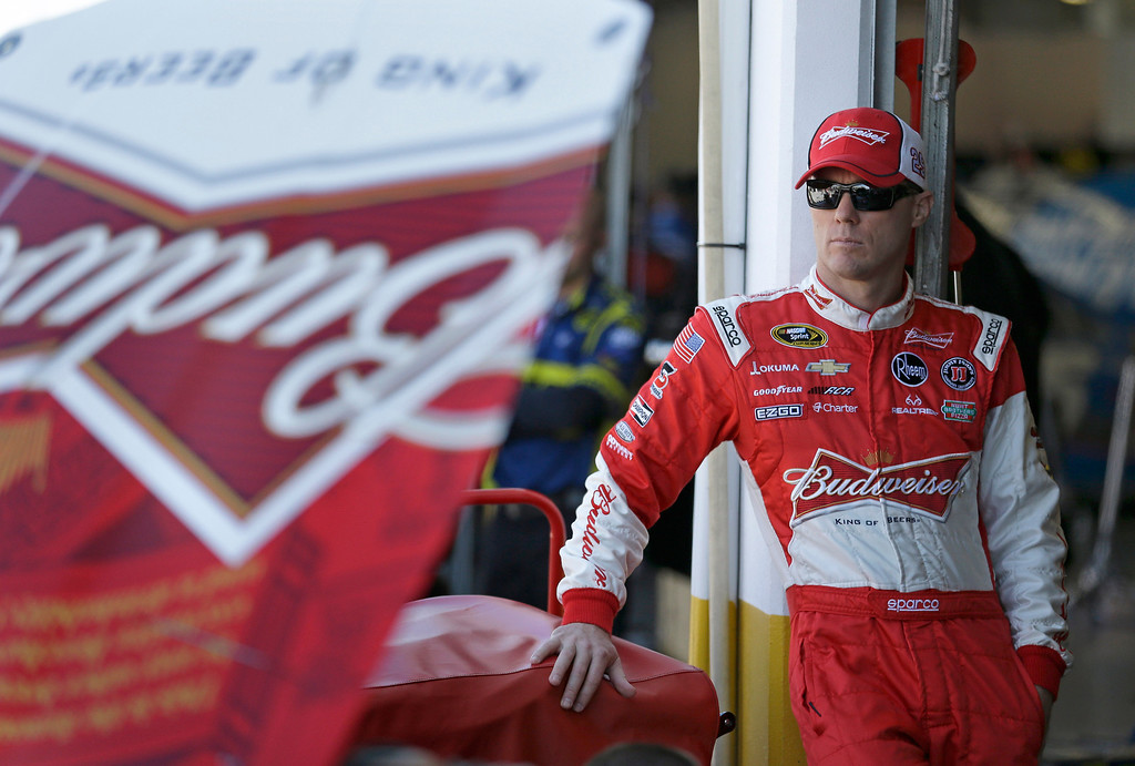 . Kevin Harvick stands by his car before going out on the track during practice for the NASCAR Daytona 500 Sprint Cup Series auto race at Daytona International Speedway, Wednesday, Feb. 20, 2013, in Daytona Beach, Fla. (AP Photo/John Raoux)