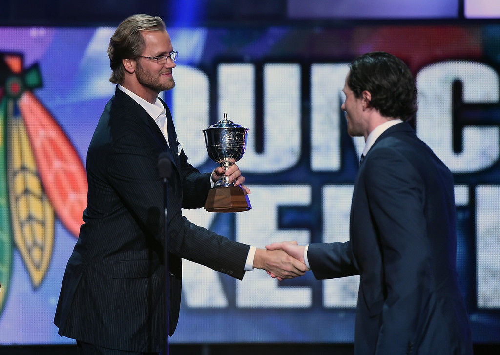 . LAS VEGAS, NV - JUNE 24: Chris Pronger of the Philadelphia Flyers presents Duncan Keith of the Chicago Blackhawks with the James Norris Memorial Trophy during the 2014 NHL Awards at the Encore Theater at Wynn Las Vegas on June 24, 2014 in Las Vegas, Nevada.  (Photo by Ethan Miller/Getty Images)