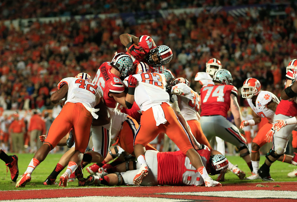 . MIAMI GARDENS, FL - JANUARY 03:  Carlos Hyde #34 of the Ohio State Buckeyes jumps across the goal line for a touchdown in the third quarter against the Clemson Tigers during the Discover Orange Bowl at Sun Life Stadium on January 3, 2014 in Miami Gardens, Florida.  (Photo by Chris Trotman/Getty Images)