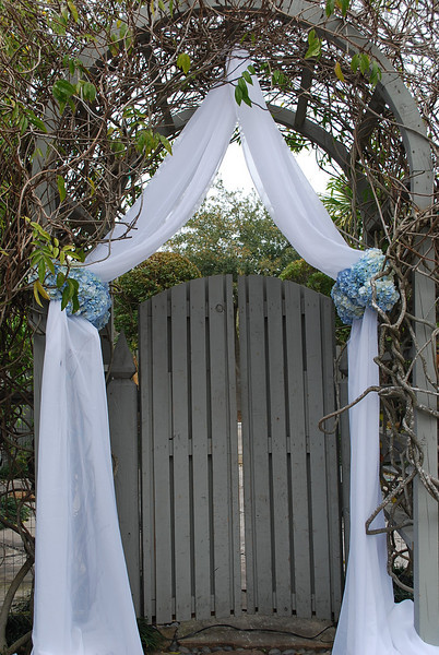Our white panel was used to drape the inside of this wooden arbor for a ceremony :)