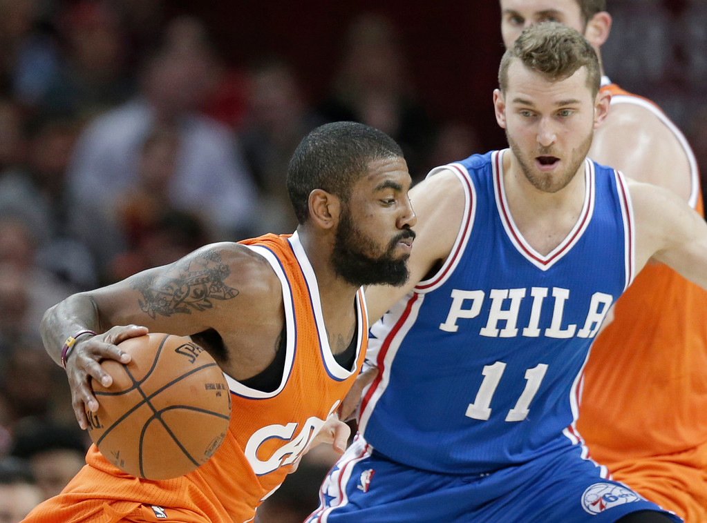 . Cleveland Cavaliers\' Kyrie Irving, left, drives past Philadelphia 76ers\' Nik Stauskas in the second half of an NBA basketball game, Friday, March 31, 2017, in Cleveland. (AP Photo/Tony Dejak)