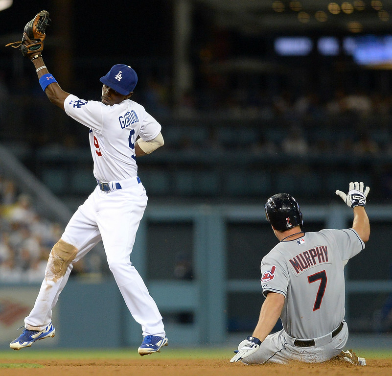 . Los Angeles Dodgers Dee Gordon is late with the tag on David Murphy of the Cleveland Indians July 1, 2014 in Los Angeles.(Andy Holzman/Los Angeles Daily News)