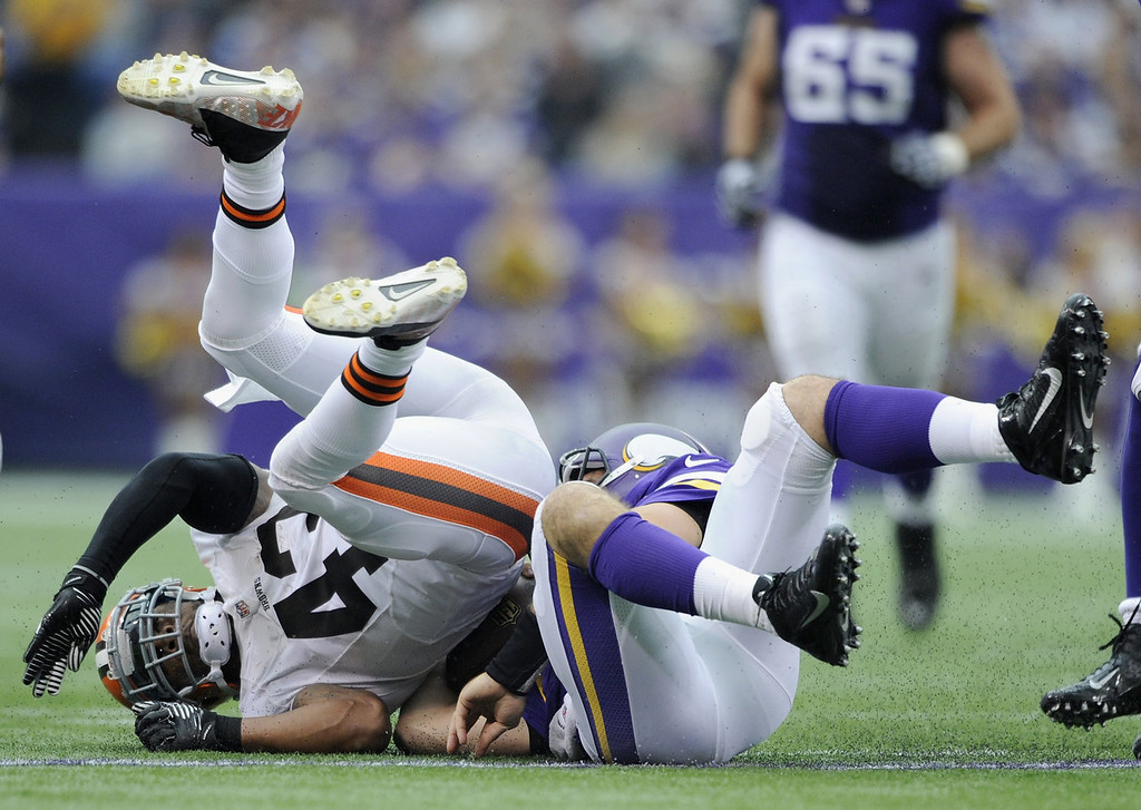 . T.J. Ward #43 of the Cleveland Browns collides with Christian Ponder #7 of the Minnesota Vikings as Ponder slides during the second quarter of the game on September 22, 2013 at Mall of America Field at the Hubert H. Humphrey Metrodome in Minneapolis, Minnesota. (Photo by Hannah Foslien/Getty Images)