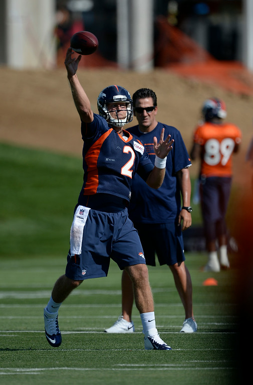 . Denver Broncos quarterback Zac Dysert (2) throws a pass during drills during the first day of the Denver Broncos 2014 training camp July 24, 2014 at Dove Valley. (Photo by John Leyba/The Denver Post)