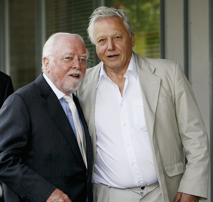 . British Film Actor And Director Lord Richard Attenborough Dies Aged 90 LEICESTER, ENGLAND - JULY 13:  Lord Richard Attenborough and Sir David Attenborough pose outside the \'Richard Attenbororugh\' Building at the University of Leicester, before they are awarded the title of Distinguished Honorary Fellowships from the University of Leicester, at De Montfort Hall on July 13, 2006 in Leicester, England. (Photo by Matthew Lewis/Getty Images)
