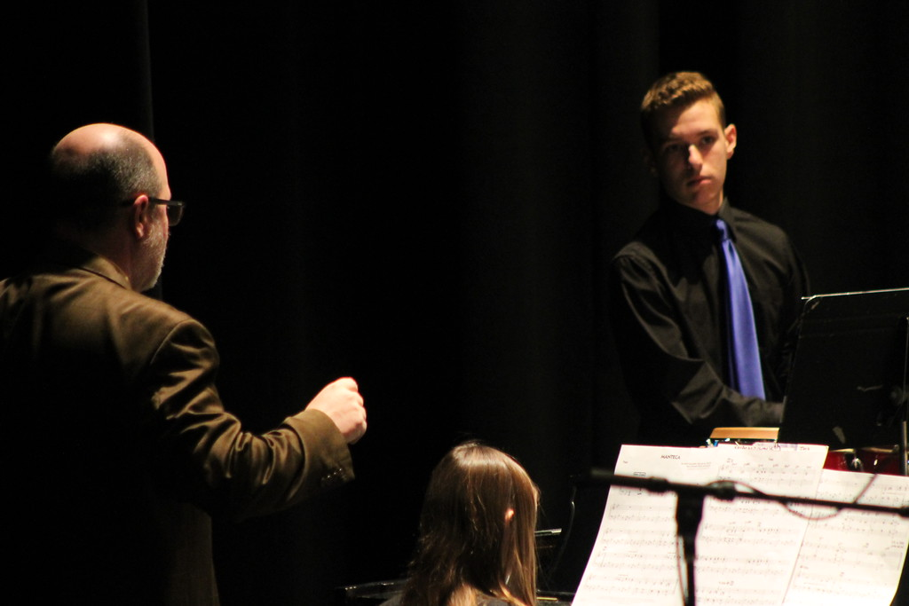 . Jack Sumrada, auxillary drum player with Wickliffe High School Jazz band listens as Kent Engelhardt, member of Jazz Education Network, active performer and composer offers feedback after performing in the Lakeland Jazz festival at Lakeland Community College on March 16. Kristi Garabrandt - The News-Herald