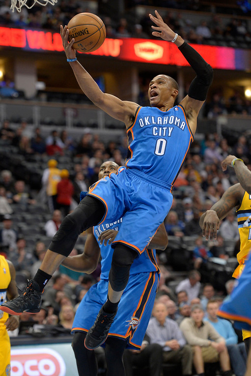 . Oklahoma City Thunder point guard Russell Westbrook (0) goes up for a basket during the fourth quarter against the Denver Nuggets December 17, 2013 at Pepsi Center. (Photo by John Leyba/The Denver Post)