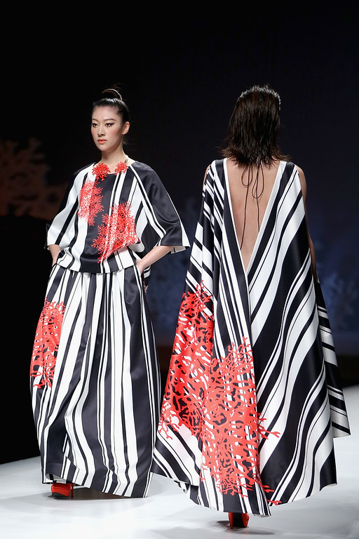 . Two models showcase designs on the runway at SEC Qi Gang Collection show during Mercedes-Benz China Fashion Week Spring/Summer 2015 at Beijing Hotel on October 29, 2014 in Beijing, China.  (Photo by Feng Li/Getty Images)