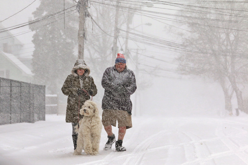 . Cheryl and Bob Gaudet walk their Goldendoodle Khaleesi down 4th Street in Leominster during the storm on Tuesday March 14, 2017. SENTINEL & ENTERPRISE/JOHN LOVE